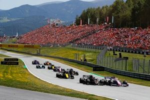 Sergio Perez, Racing Point RP19, leads Kevin Magnussen, Haas F1 Team VF-19, Daniel Ricciardo, Renault F1 Team R.S.19, Romain Grosjean, Haas F1 Team VF-19, Lance Stroll, Racing Point RP19, and the remainder of the field at the start