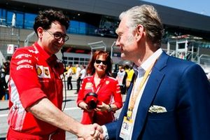 Mattia Binotto, Team Principal Ferrari and Sean Bratches, Managing Director of Commercial Operations, Formula One Group on the grid