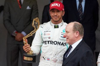 Lewis Hamilton, Mercedes AMG F1, 1st position, celebrates on the podium with his trophy