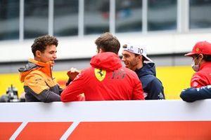 Lando Norris, McLaren, Charles Leclerc, Ferrari, and Pierre Gasly, AlphaTauri, in the drivers parade