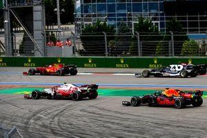 Antonio Giovinazzi, Alfa Romeo Racing C41, and Max Verstappen, Red Bull Racing RB16B, run wide at the start as Charles Leclerc, Ferrari SF21, Yuki Tsunoda, AlphaTauri AT02, and Valtteri Bottas, Mercedes W12
