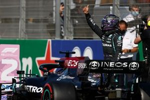 Lewis Hamilton, Mercedes, gives a thumbs up from Parc Ferme