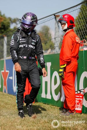 Lewis Hamilton, Mercedes, walks away after a crash with Max Verstappen, Red Bull Racing