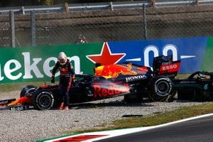 Max Verstappen, Red Bull Racing, walks away after crashing out with Lewis Hamilton, Mercedes