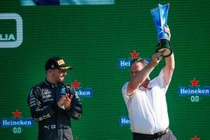 Valtteri Bottas, Mercedes, 3rd position, and Zak Brown, CEO, McLaren Racing, on the podium