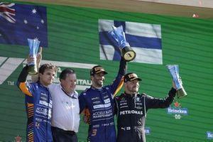 Lando Norris, McLaren, 2nd position, Zak Brown, CEO, McLaren Racing, Daniel Ricciardo, McLaren, 1st position, and Valtteri Bottas, Mercedes, 3rd position, on the podium