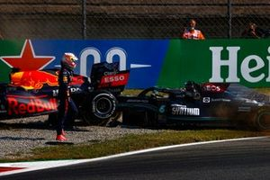 Max Verstappen, Red Bull Racing RB16B, walks away from his car after crashing out with Lewis Hamilton, Mercedes