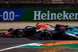 Sergio Perez, Red Bull Racing RB16B, battles with Lance Stroll, Aston Martin AMR21