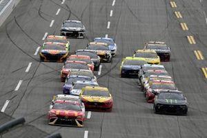 Bubba Wallace, 23XI Racing, Toyota Camry McDonald's and Kurt Busch, Chip Ganassi Racing, Chevrolet Camaro Monster Energy