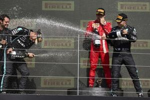 Lewis Hamilton, Mercedes, 1st position, and Valtteri Bottas, Mercedes, 3rd position, celebrate with Champagne on the podium