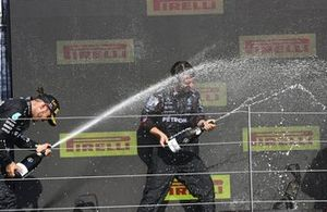 Lewis Hamilton, Mercedes, 1st position, sprays the victory Champagne at his team mate