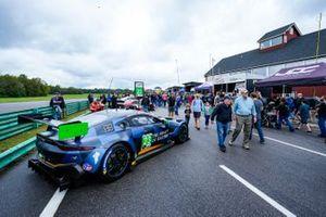 Fans enjoy walking the pre-race grid.