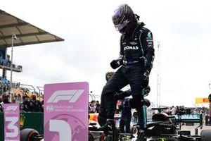 Lewis Hamilton, Mercedes, celebrates pole on arrival in Parc Ferme