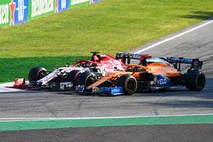 Kimi Raikkonen, Alfa Romeo Racing C39 and Carlos Sainz Jr., McLaren MCL35 go side to side