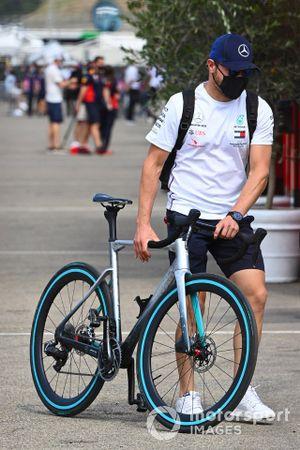 Valtteri Bottas, Mercedes-AMG Petronas F1, wheels his bicycle in the paddock