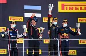 Louis Deletraz, Charouz Racing System, 2nd position, the ART podium representative, Christian Lundgaard, ART Grand Prix, 1st position, and Juri Vips, Dams, 2nd position, on the podium with their trophies