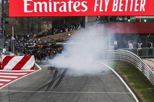 Esteban Ocon, Renault F1 Team R.S.20, locks up at the pit lane entrance