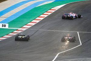 Lance Stroll, Racing Point RP20, Alex Albon, Red Bull Racing RB16, and Esteban Ocon, Renault F1 Team R.S.20, as sparks fly