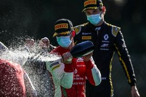 Race Winner Mick Schumacher, Prema Racing and Christian Lundgaard, ART Grand Prix celebrate on the podium with the champagne