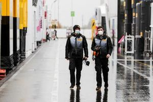 Pirelli technicians in the pit lane