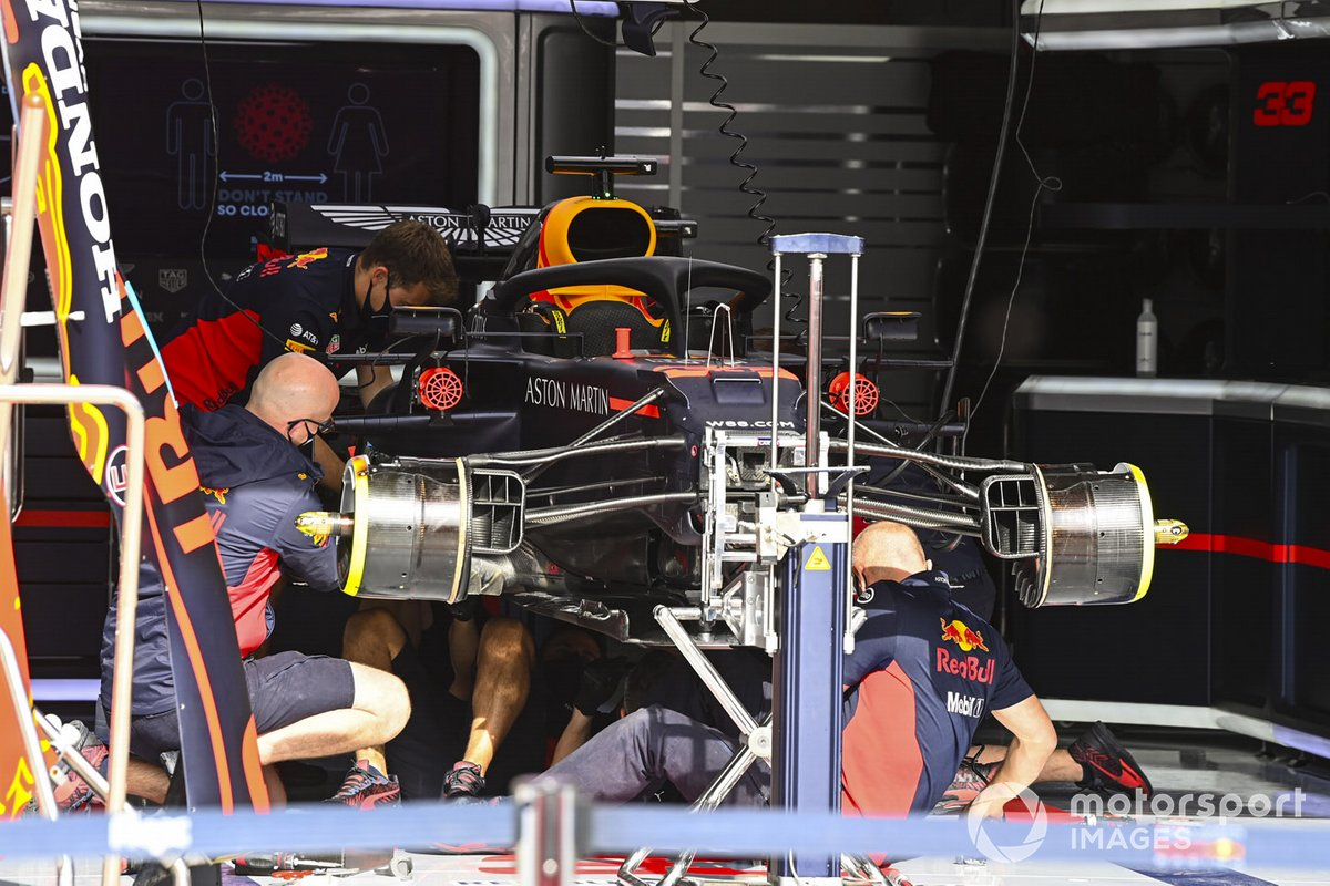 Mechanics build the car of Max Verstappen, Red Bull Racing RB16, in the garage