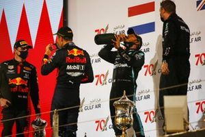 Max Verstappen, Red Bull Racing, 2nd position, Alex Albon, Red Bull Racing, 3rd position, and Lewis Hamilton, Mercedes-AMG F1, 1st position, celebrate on the podium
