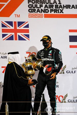 Sheikh Abdullah bin Hamad bin Isa Al Khalifa presents Lewis Hamilton, Mercedes-AMG F1, 1st position, with the winners trophy