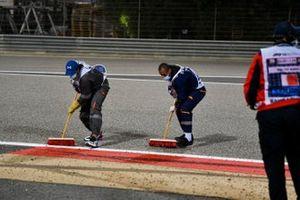 Marshals sweep the circuit of debris