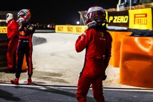 Max Verstappen, Red Bull Racing, Charles Leclerc, Ferrari, at the side of the track after retiring