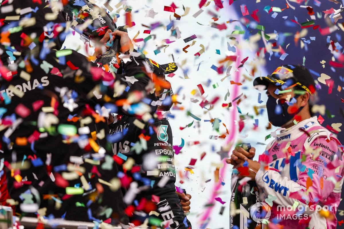 Toto Wolff, Executive Director (Business), Mercedes AMG, Lewis Hamilton, Mercedes-AMG F1, 1st position, Sebastian Vettel, Ferrari, 3rd position, and Sergio Perez, Racing Point, 2nd position, celebrate with Champagne on the podium