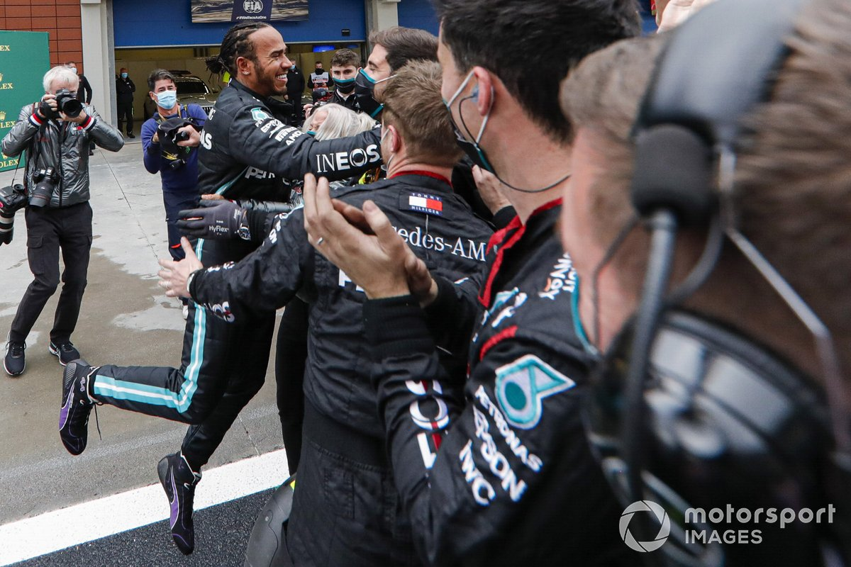Lewis Hamilton, Mercedes-AMG F1, 1st position, celebrates with his team on arrival in Parc Ferme after securing his seventh world drivers championship title