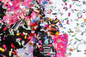 Sebastian Vettel, Ferrari, 3rd position, and Toto Wolff, Executive Director (Business), Mercedes AMG, pour Champagne over Lewis Hamilton, Mercedes-AMG F1, 1st position, on the podium