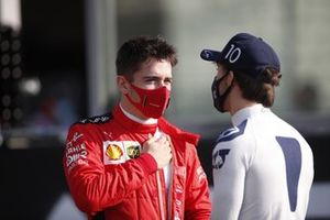 Charles Leclerc, Ferrari, talk to Pierre Gasly, AlphaTauri, on the grid for the end of season photo
