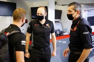 Guenther Steiner, Team Principal, Haas F1 and Mick Schumacher in the garage for his seat fitting