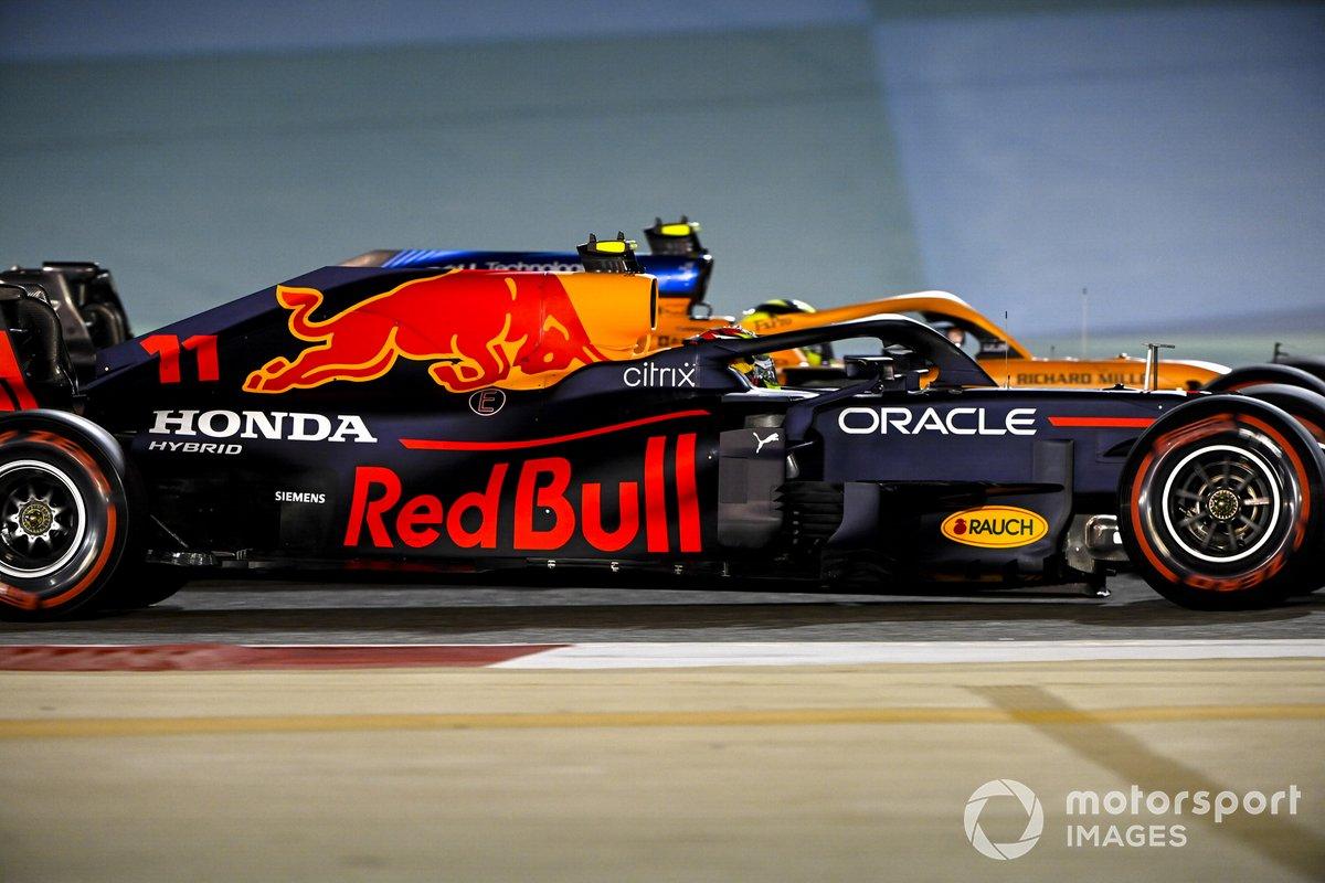 Sergio Perez, Red Bull Racing RB16B, passes Lando Norris, McLaren MCL35M