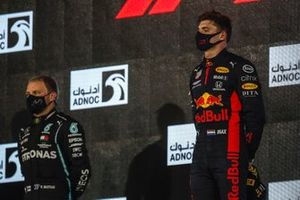 Valtteri Bottas, Mercedes-AMG F1, 2nd position, and Max Verstappen, Red Bull Racing, 1st position, on the podium