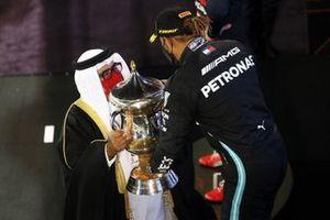 Lewis Hamilton, Mercedes, 1st position, receives his trophy on the podium