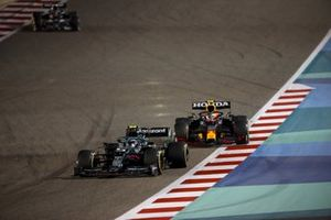 Sebastian Vettel, Aston Martin AMR21 and Sergio Perez, Red Bull Racing RB16B