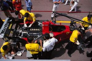 Mechanics work on Gerhard Berger's Ferrari 412T2 in the pits
