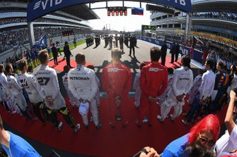 The drivers line up on the grid for the national anthems prior to the start