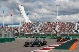 Lewis Hamilton, Mercedes AMG F1 W10, leads Carlos Sainz Jr., McLaren MCL34, Valtteri Bottas, Mercedes AMG W10, Lando Norris, McLaren MCL34, and the remainder of the field