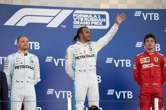 Valtteri Bottas, Mercedes AMG F1, 2nd position, Lewis Hamilton, Mercedes AMG F1, 1st position, and Charles Leclerc, Ferrari, 3rd position, on the podium