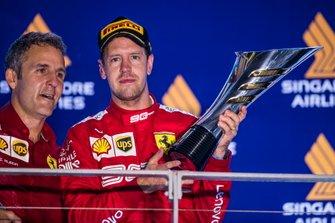 I-aki Rueda, Head of Strategy, Ferrari, and Sebastian Vettel, Ferrari, 1st position, on the podium
