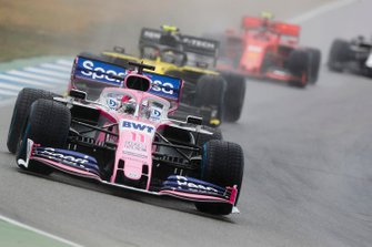 Sergio Perez, Racing Point RP19, leads Nico Hulkenberg, Renault F1 Team R.S. 19, and Charles Leclerc, Ferrari SF90