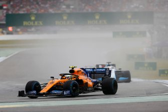 Lando Norris, McLaren MCL34, leads George Russell, Williams Racing FW42