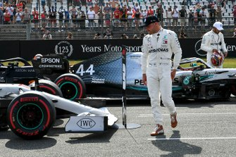 Valtteri Bottas, Mercedes AMG F1, and pole man Lewis Hamilton, Mercedes AMG F1, on the grid after Qualifying