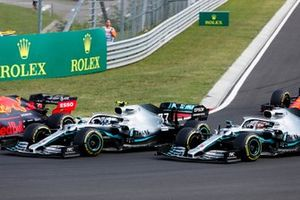 Max Verstappen, Red Bull Racing RB15, leads Valtteri Bottas, Mercedes AMG W10, and Lewis Hamilton, Mercedes AMG F1 W10, at the start