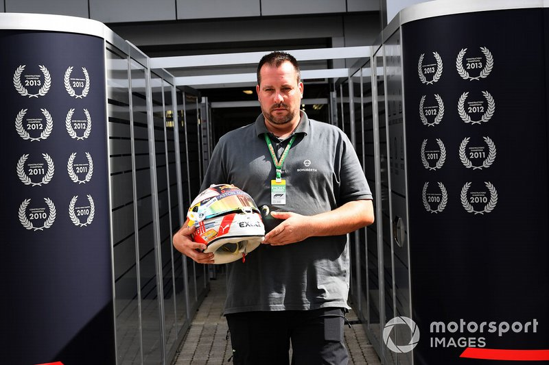A Schuberth helmet engineer with the helmet of Max Verstappen, Red Bull Racing
