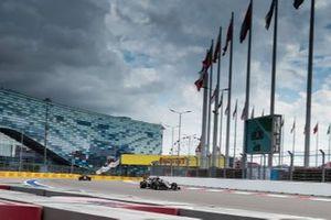 Romain Grosjean, Haas F1 Team VF-19, leads Kevin Magnussen, Haas F1 Team VF-19