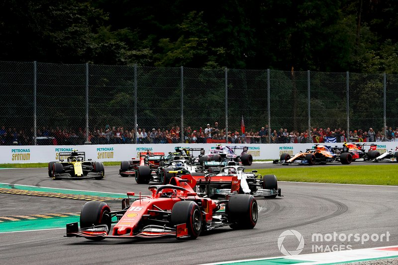 Charles Leclerc, Ferrari SF90 leads Lewis Hamilton, Mercedes W10 and Valtteri Bottas, Mercedes W10 at the second chicane on the first lap